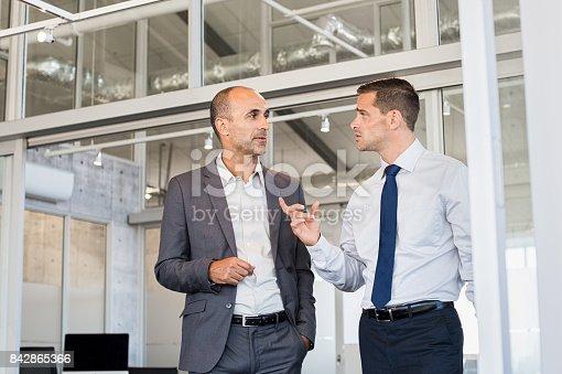 istock Businessmen discussing work 842865366