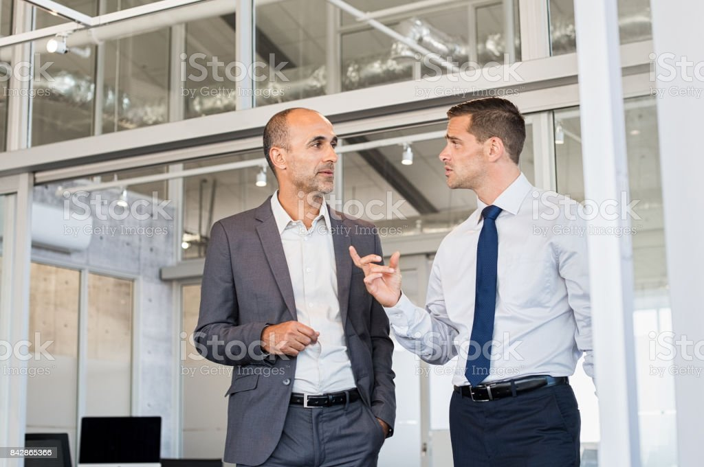 Businessmen discussing work stock photo