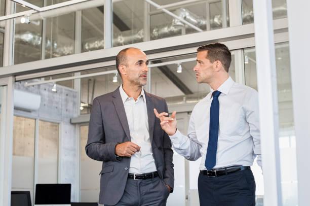 Businessmen discussing work stock photo
