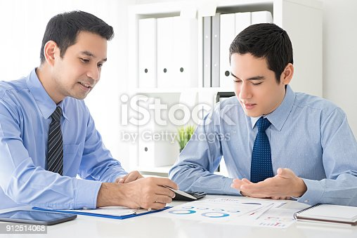 istock Businessmen discussing work presentation documents in the office 912514068