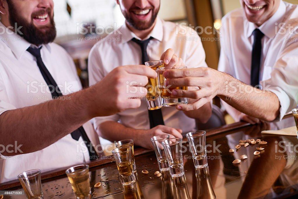 Businessmen drinking shots stock photo
