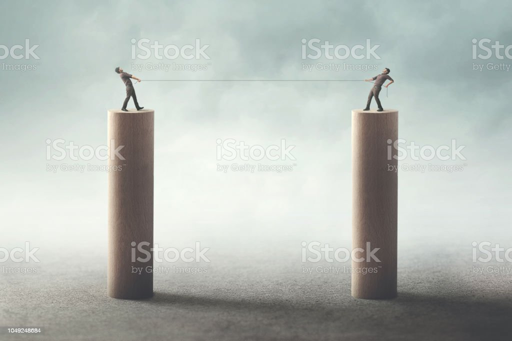 businessmen fight concept tug of war stock photo