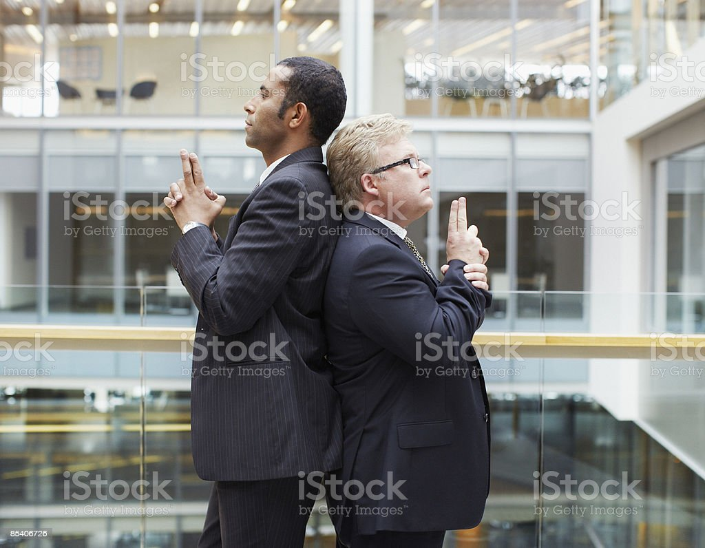Businessmen fighting symbolic duel stock photo