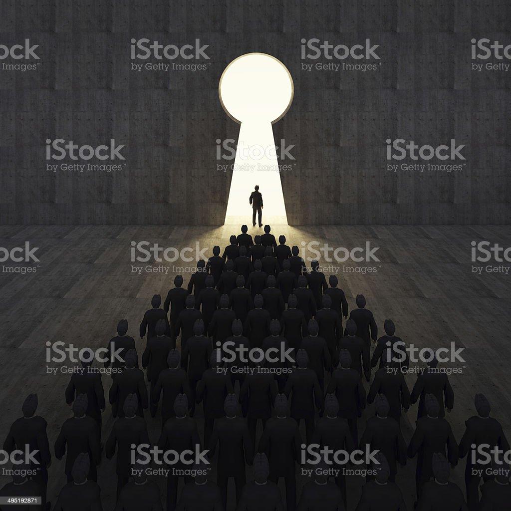 Businessmen front of key hole door concept. stock photo