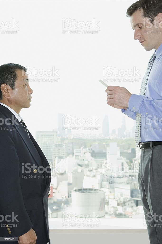 Businessmen greeting royalty-free stock photo