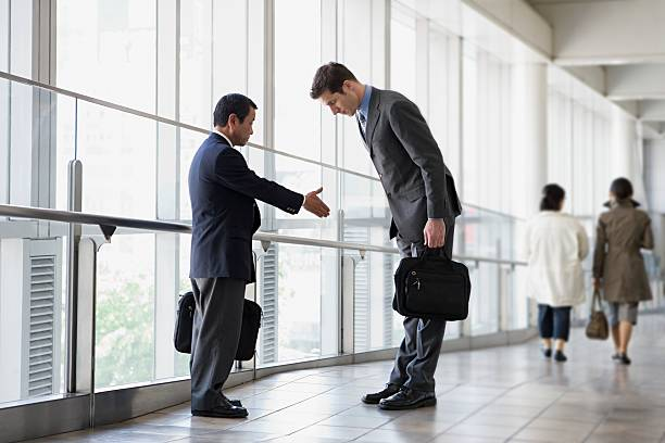 Businessmen greeting  dignity stock pictures, royalty-free photos & images