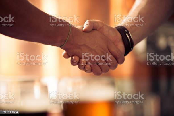 Businessmen Hand Shake At Micro Brewery Stock Photo - Download Image Now