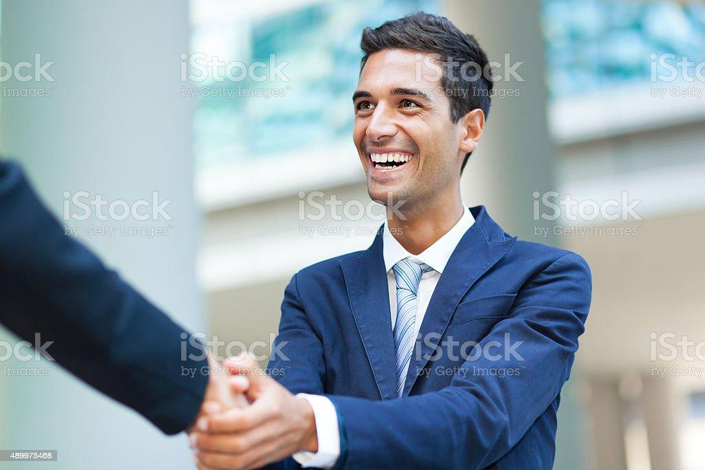 Businessmen handshake stock photo