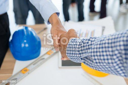 976560476istockphoto Businessmen handshake 953718350