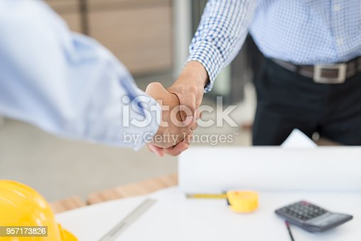 1071990712istockphoto Businessmen handshake 957173826