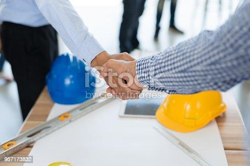 976560476istockphoto Businessmen handshake 957173832