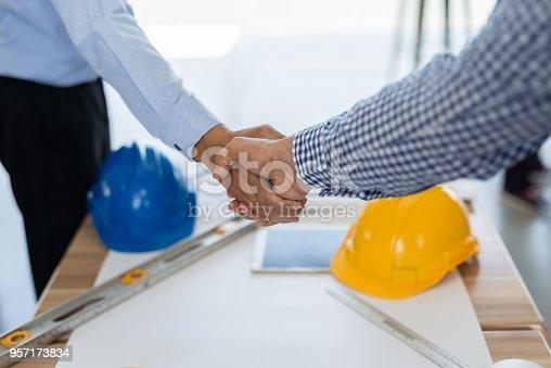 976560476istockphoto Businessmen handshake 957173834