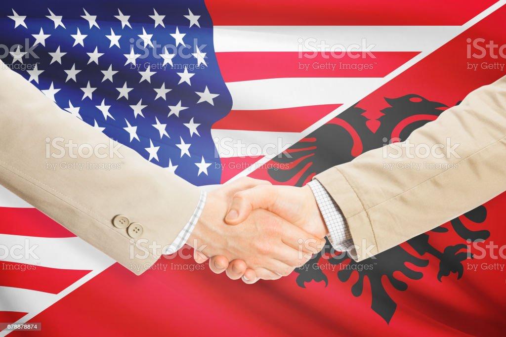 Businessmen handshake - United States and Albania royalty-free stock photo
