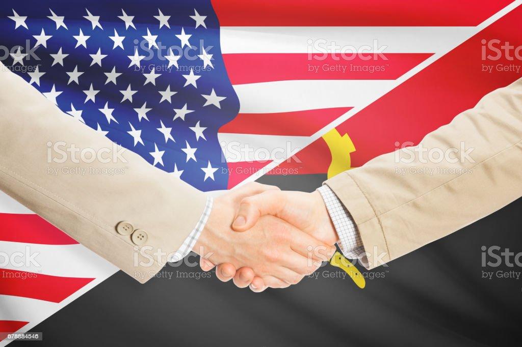 Businessmen handshake - United States and Angola royalty-free stock photo