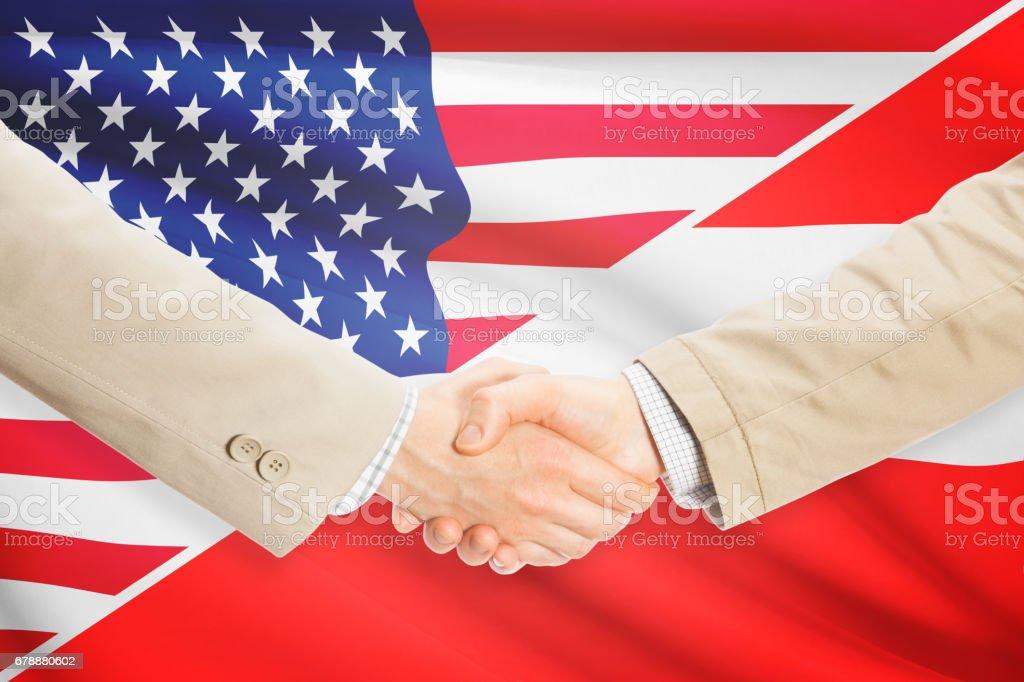 Businessmen handshake - United States and Austria royalty-free stock photo