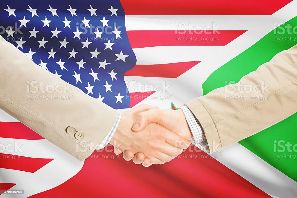 Businessmen handshake - United States and Burundi stock photo