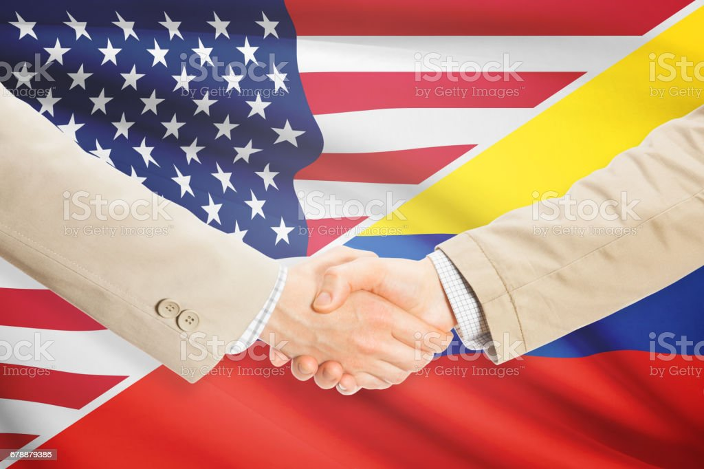 Businessmen handshake - United States and Colombia royalty-free stock photo
