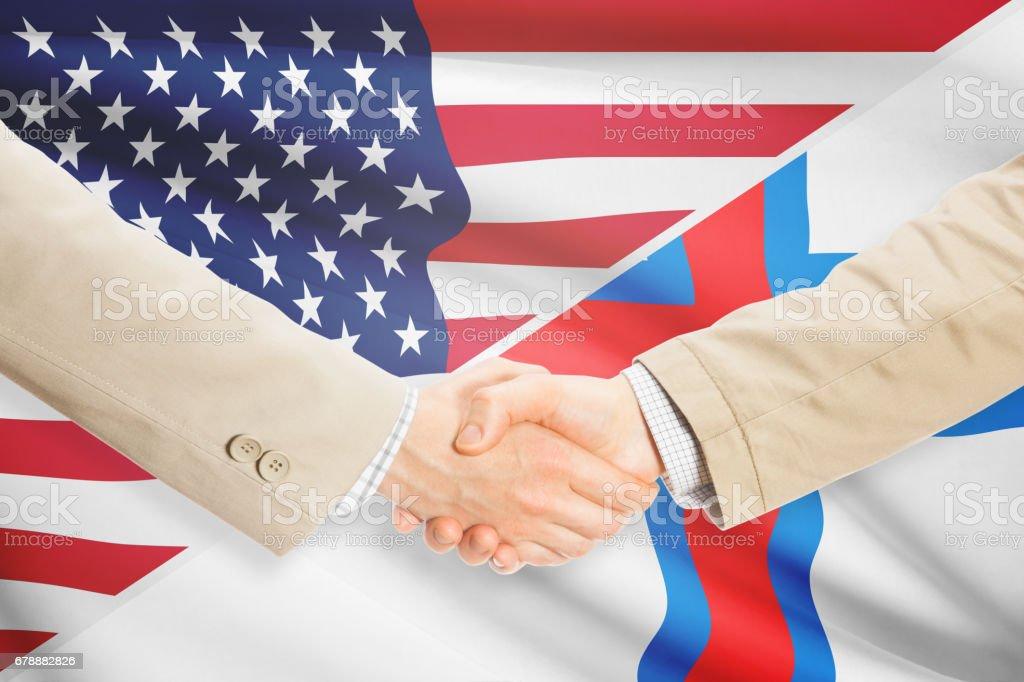 Businessmen handshake - United States and Faroe Islands photo libre de droits