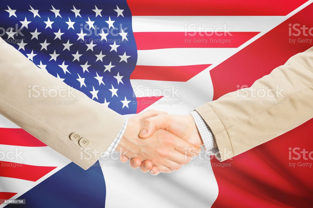 Businessmen handshake - United States and France royalty-free stock photo