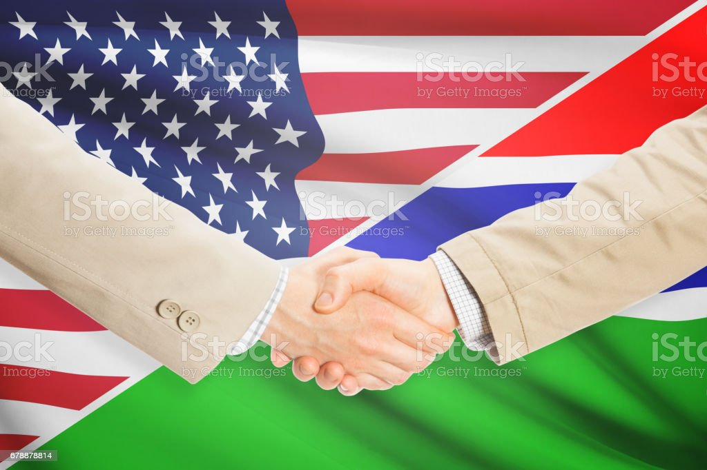 Businessmen handshake - United States and Gambia royalty-free stock photo