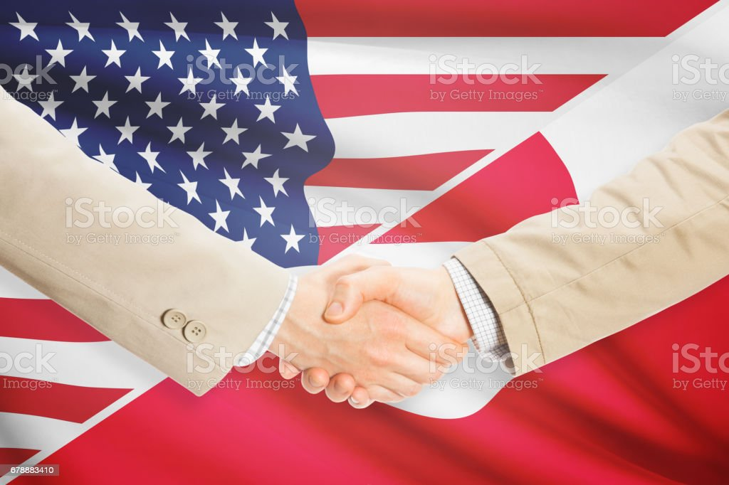 Businessmen handshake - United States and Greenland photo libre de droits