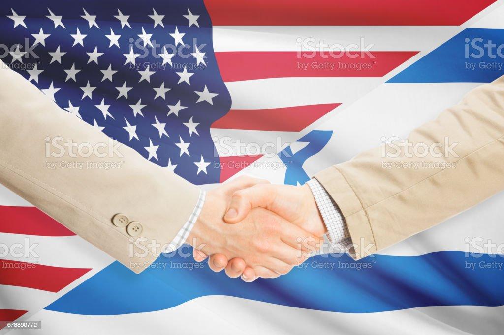 Businessmen handshake - United States and Israel royalty-free stock photo