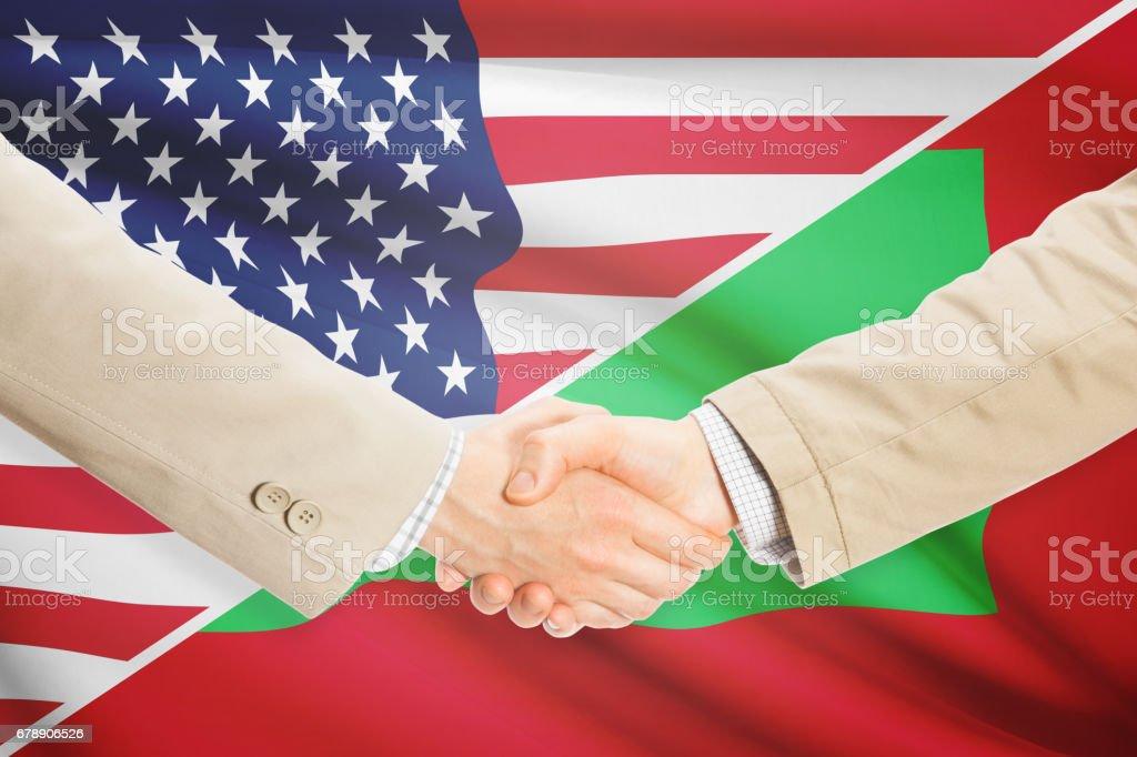 Businessmen handshake - United States and Maldives royalty-free stock photo