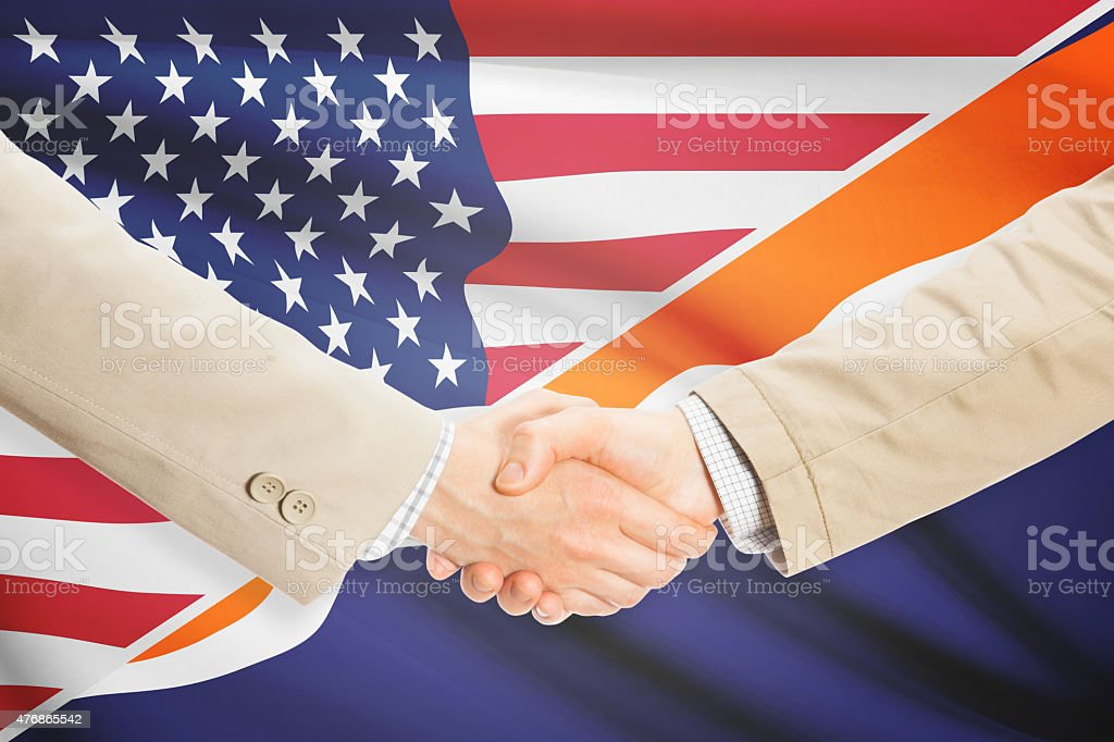 Businessmen handshake - United States and Marshall Islands stock photo