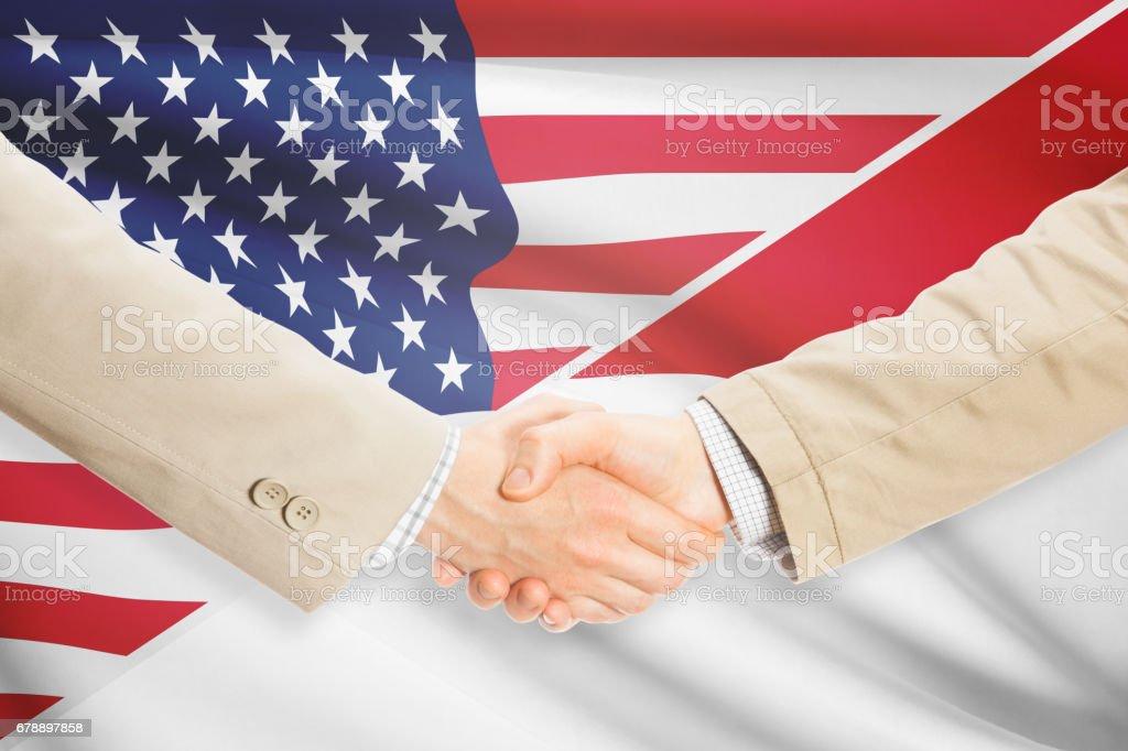 Businessmen handshake - United States and Monaco royalty-free stock photo