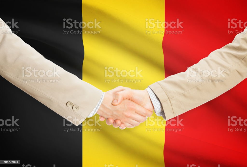 Businessmen handshake with flag on background - Belgium Lizenzfreies stock-foto