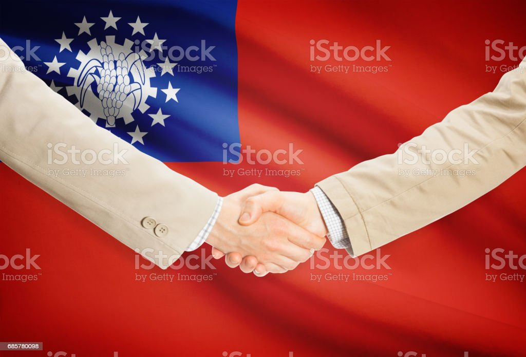 Businessmen handshake with flag on background - Burma royalty-free stock photo