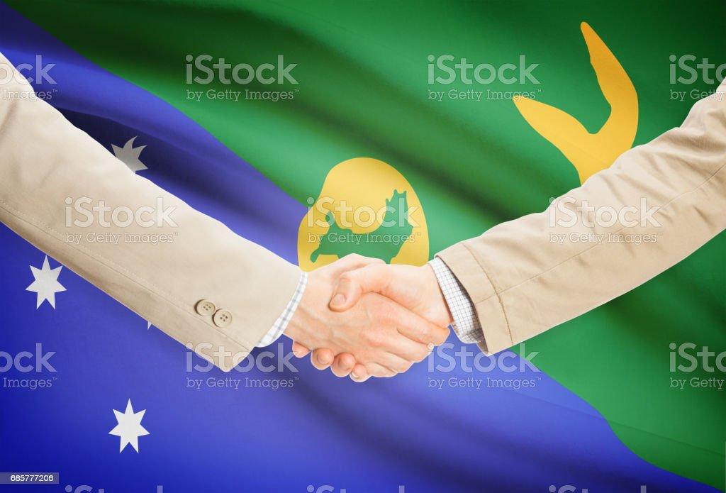 Businessmen handshake with flag on background - Christmas Island photo libre de droits