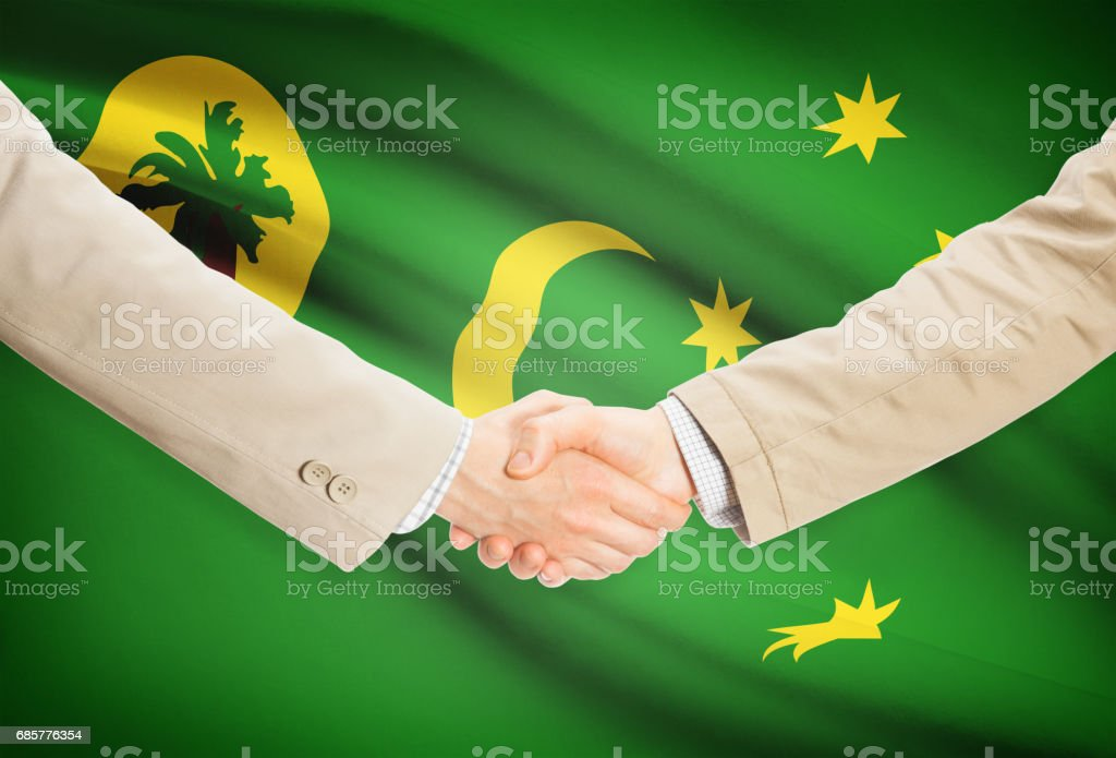 Businessmen handshake with flag on background - Cocos (Keeling) Islands royalty-free stock photo