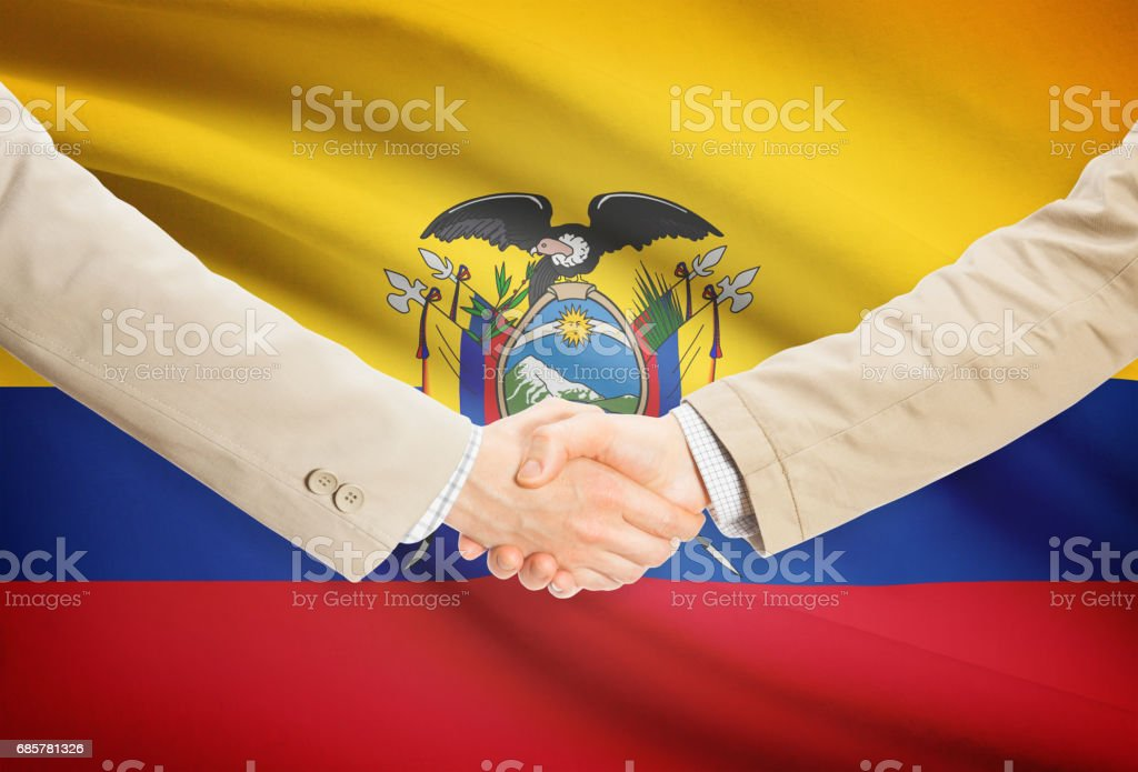 Businessmen handshake with flag on background - Ecuador royalty-free stock photo