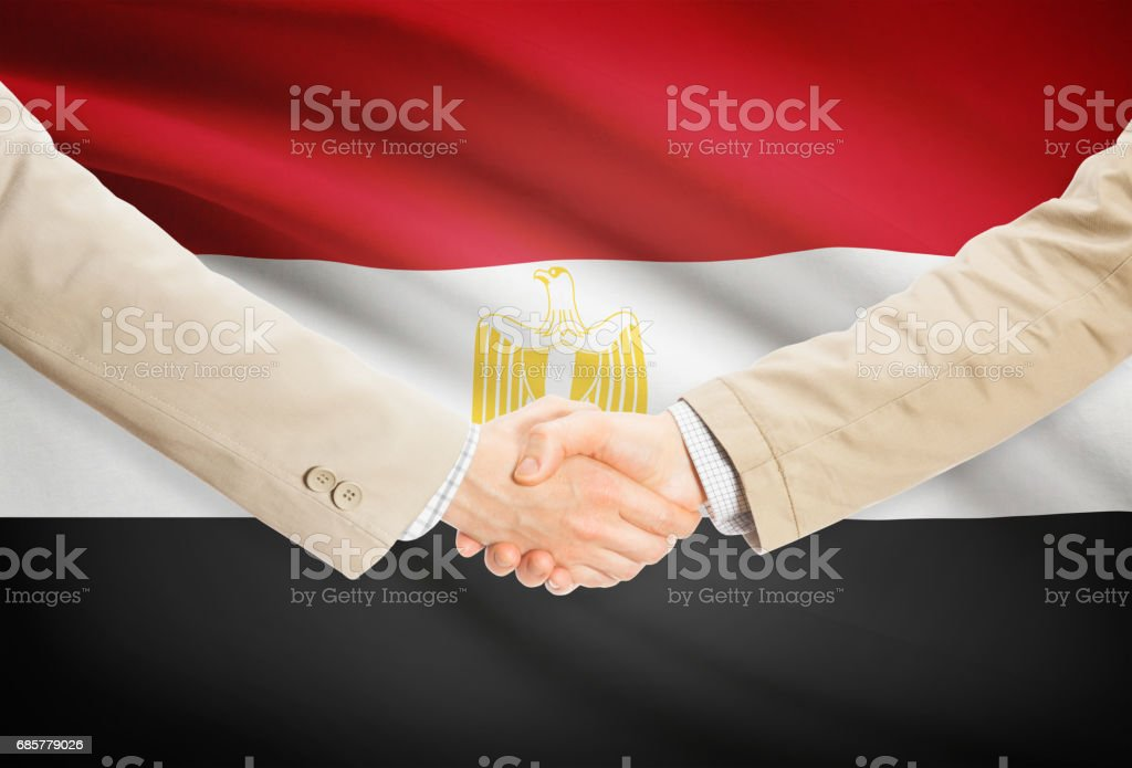 Businessmen handshake with flag on background - Egypt royalty-free stock photo