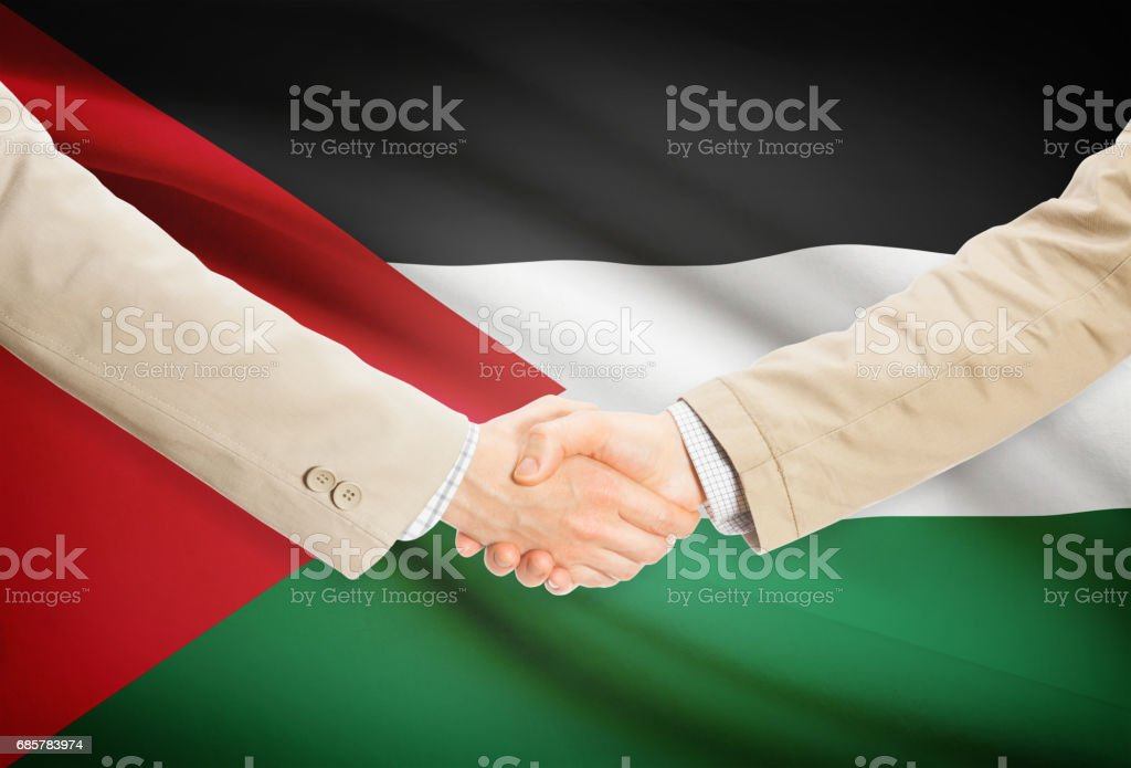 Businessmen handshake with flag on background - Jordan royalty-free stock photo