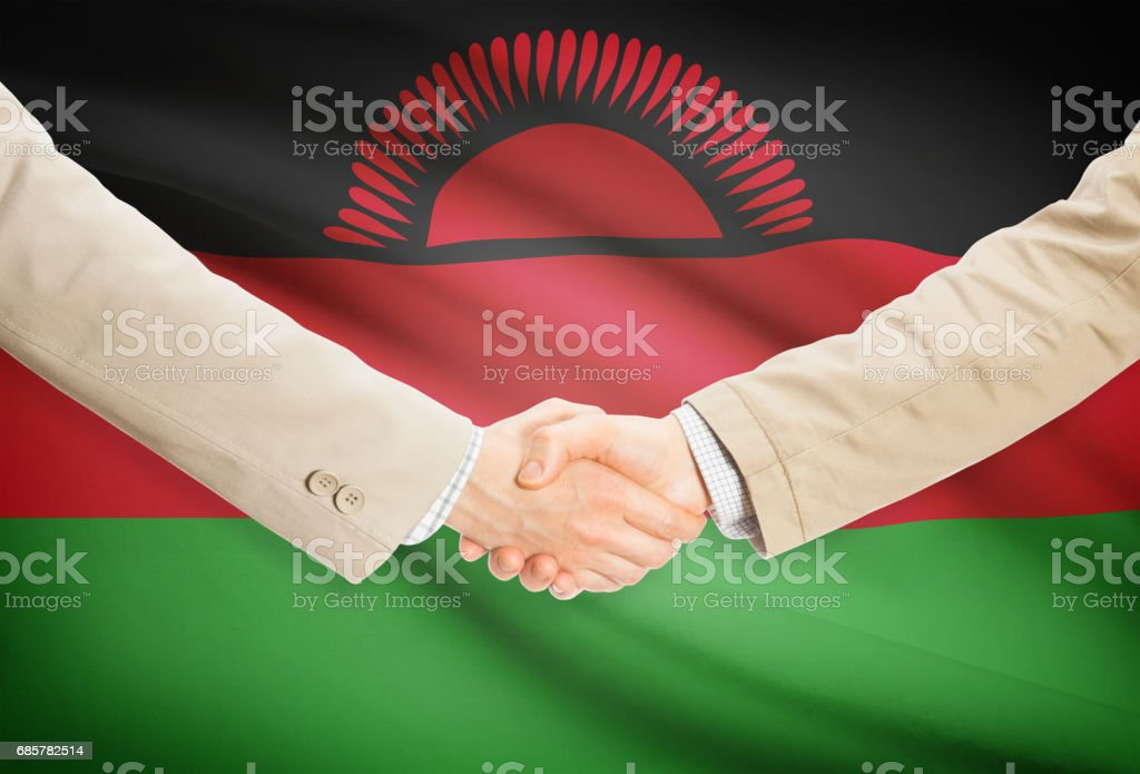Businessmen handshake with flag on background - Malawi Lizenzfreies stock-foto