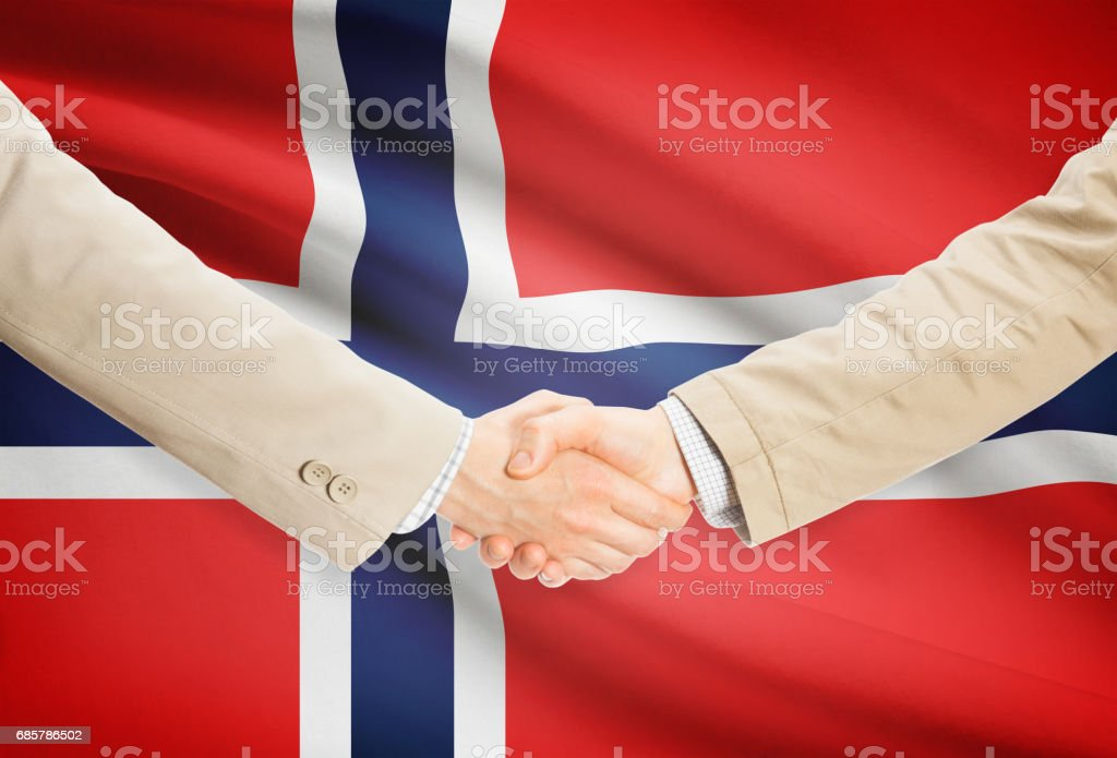 Businessmen handshake with flag on background - Norway royalty-free stock photo