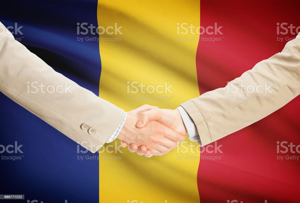 Businessmen handshake with flag on background - Romania ロイヤリティフリーストックフォト