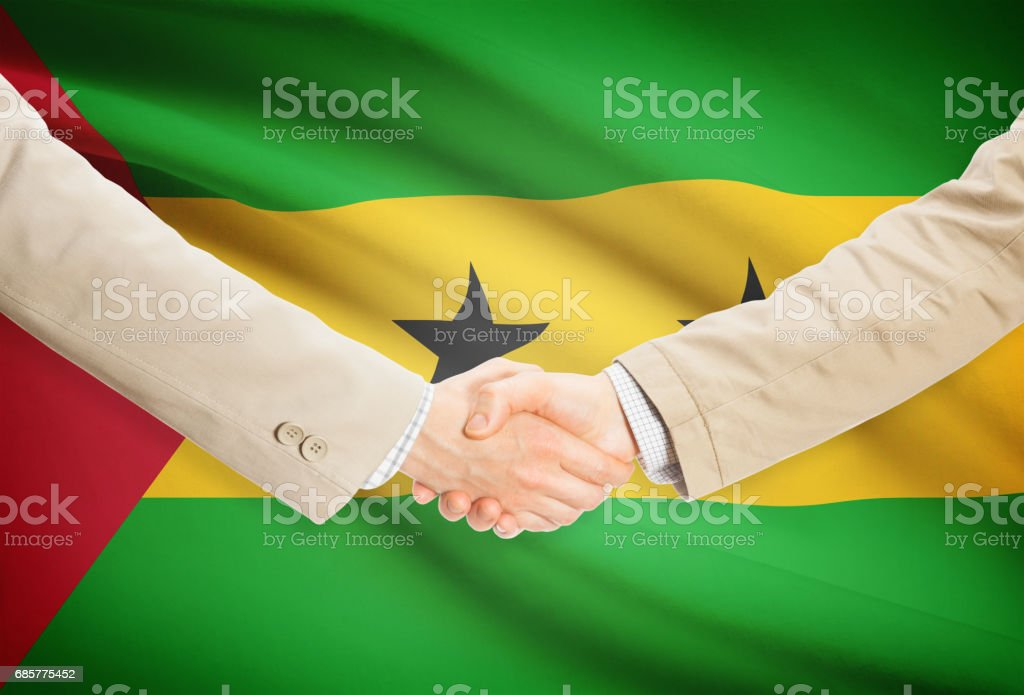Businessmen handshake with flag on background - Sao Tome and Principe royalty-free stock photo