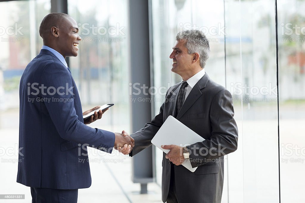businessmen handshaking stock photo