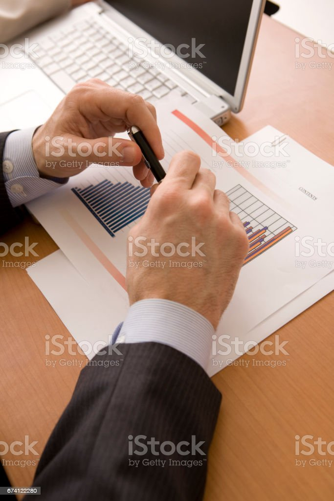 Businessmen have a pen at hand royalty-free stock photo