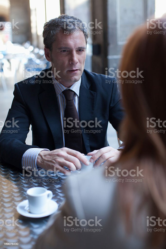 Businessmen having coffee in sidewalk cafe royalty-free stock photo