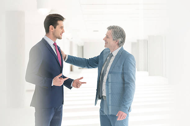 Businessmen having discussion in new office stock photo