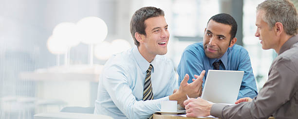 Businessmen having meeting in office  persuasion stock pictures, royalty-free photos & images