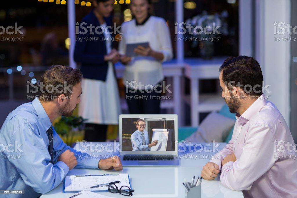Businessmen having video conference stock photo