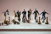 istock Businessmen hitting chess figures 1266169477