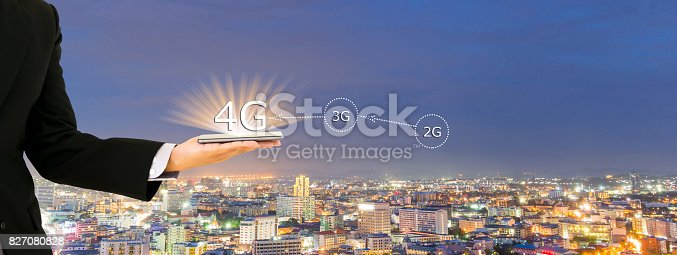 istock Businessmen hold a smartphone with digital pattern to view social data 4G 827080828