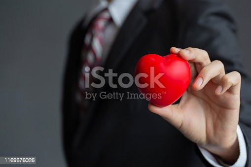 istock Businessmen holding a red heart.customer relationship management 1169676026