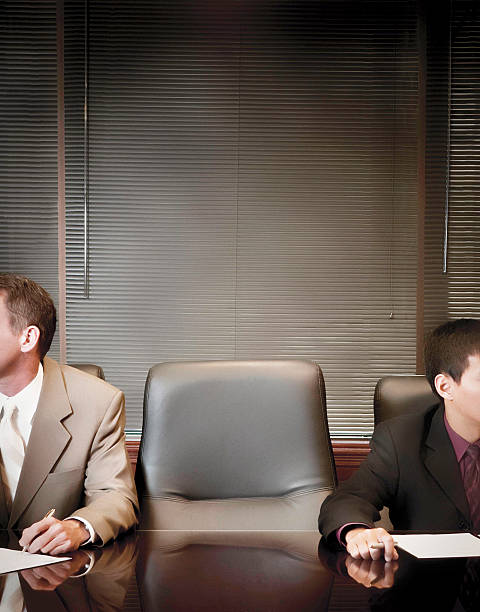 businessmen in boardroom with empty chair. - abandoned stock photos and pictures